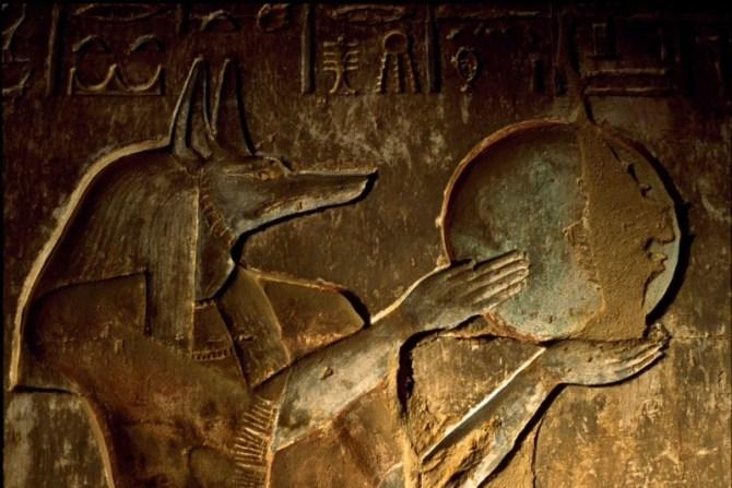Anubis holding globe ancient Egypt