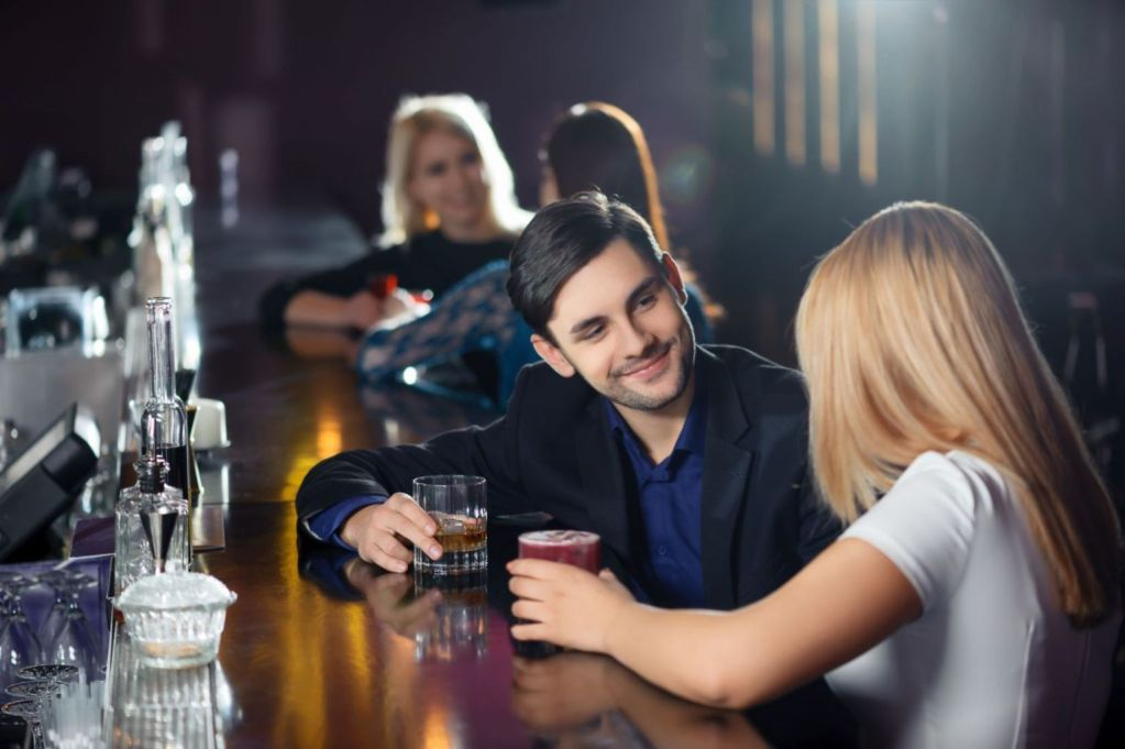 38559452 - long night. couple joyfully interacting by the bar counter in nightclub or restaurant