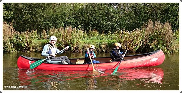 Three boys in a canoe