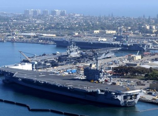 Aircraft carriers Carl Vinson, Nimitz and Ronald Reagan, top to bottom, at North Island Naval Air Station in Coronado, Calif., this week./Navy photo