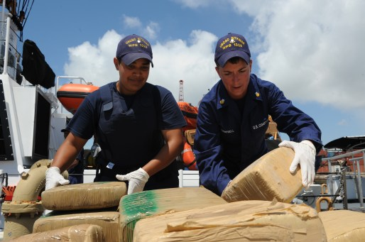 Crewmembers aboard Coast Guard Cutter Sitkinak stack nearly 1,000 pounds of marijuana at the Bas