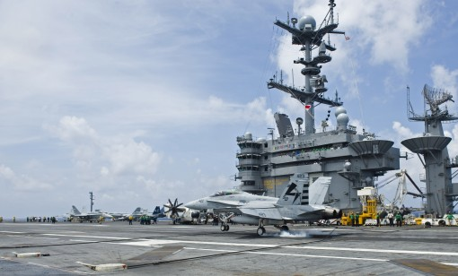An F/A-18D Hornet makes an autonomous landing on the carrier Harry S. Truman.