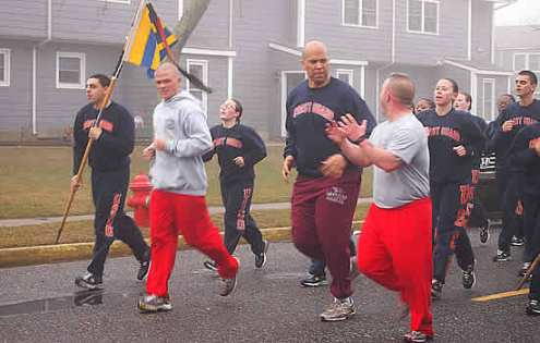 Booker interacts with Coasties during a Saturday-morning run in Cape May, N.J. (Photo courtesy of Jane XXXX/The Cape May Times)