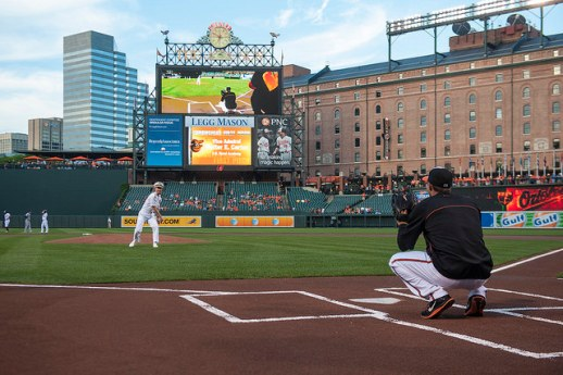 Vice Adm. Ted Carter, the U.S. Naval Academy superintendent  throws the opening pitch on Aug. 25 at Oriole Stadium at Camden Yards in Baltimore.  (MC2 Tyler Caswell / Navy)