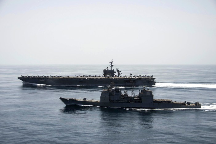The carrier Theodore Roosevelt and the cruiser Normandy conducting maritime security operations. (Credit: Mass Communication Specialist 3rd Class Anthony N. Hilkowski)
