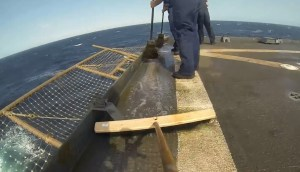 Go-Pro video of sweeping standing water -- a nice touch. (Credit: USS Comstock, via YouTube.)
