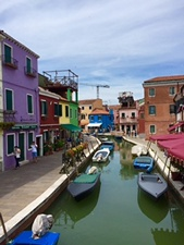 Burano canal boats houses