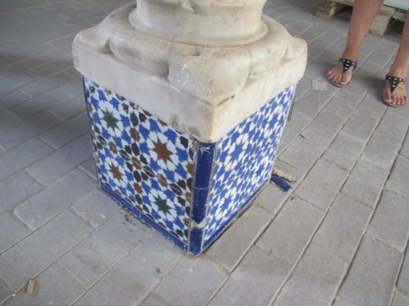 Beautoiful ceramic tiles on pillar base in the museum's entrance.