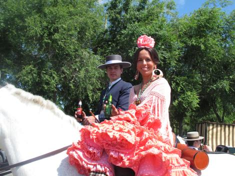 One of my favourite sights: a frilly pink flamenca dress-clad romera on her horse.