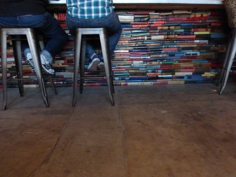 Books stacked up under the bar.