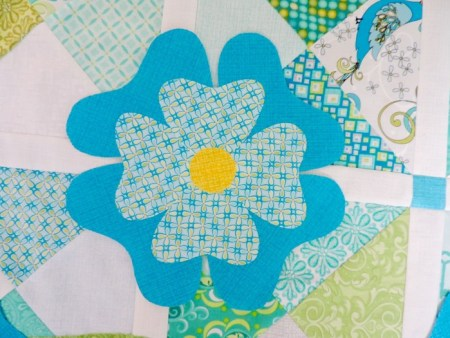 flower from blue and green quilt