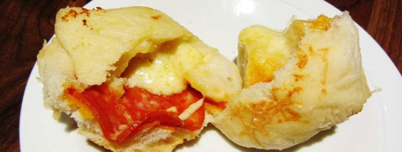 Pull apart stuffed pizza bread rolls filled with cheese and chorizo