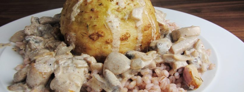 Whole roasted celeriac with pearl barley and curried mushrooms