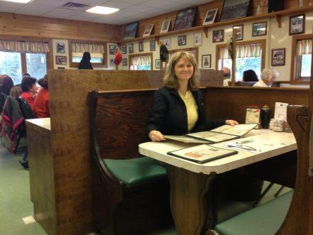 Lanita looking over the menu at Moody's Diner.