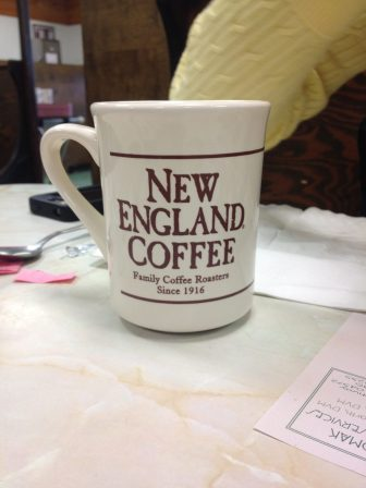 A Mug advertising New England Coffee.