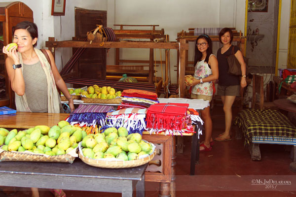 Here's my friend Tanya who kept on smelling the fragrant mangoes (can't blame her, they smell so good), her daughter Isabella and another friend Len who got interested with the home's wooden handloom-weaving machine.