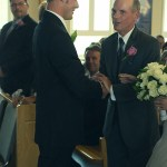 Father shakes Grooms hand