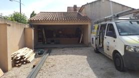 Installation d'un volet roulant en prote de garage