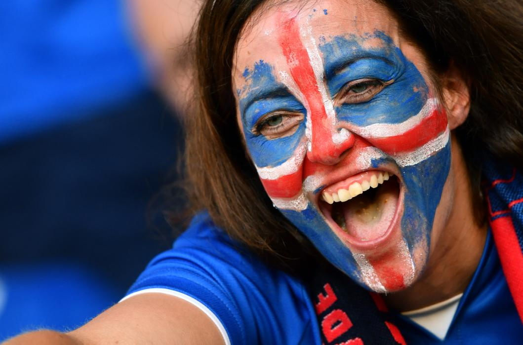 An Iceland supporter cheers prior to the Euro 2016 round of 16 football match between England and Iceland at the Allianz Riviera stadium in Nice on June 27, 2016. / AFP PHOTO / BERTRAND LANGLOIS