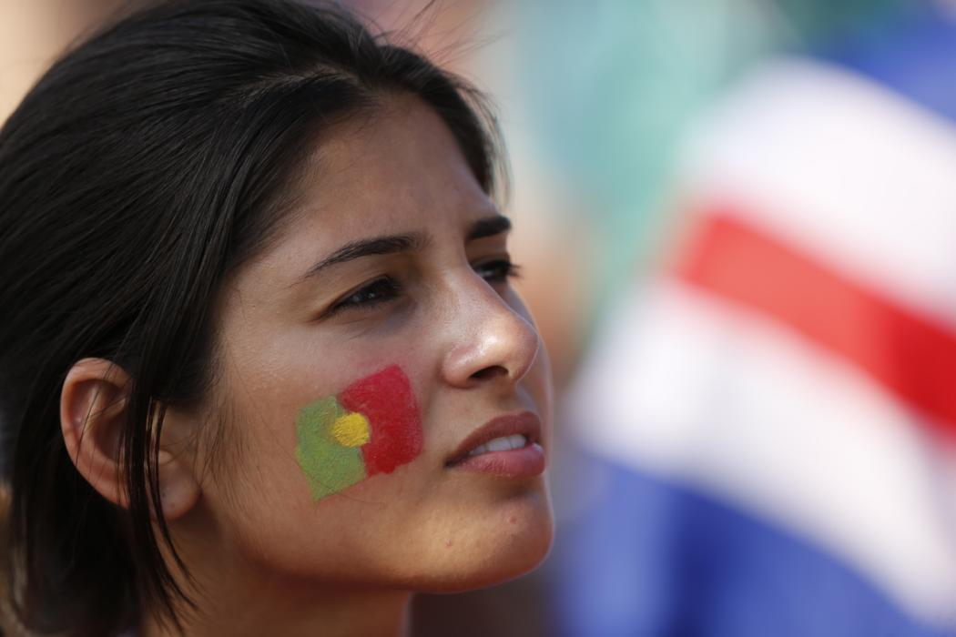 A Portuguese supporter arrives at the Stade de France in Saint-Denis prior to the Euro 2016 football tournament final match between Portugal and France, on July 10, 2016. / AFP PHOTO / MATTHIEU ALEXANDRE