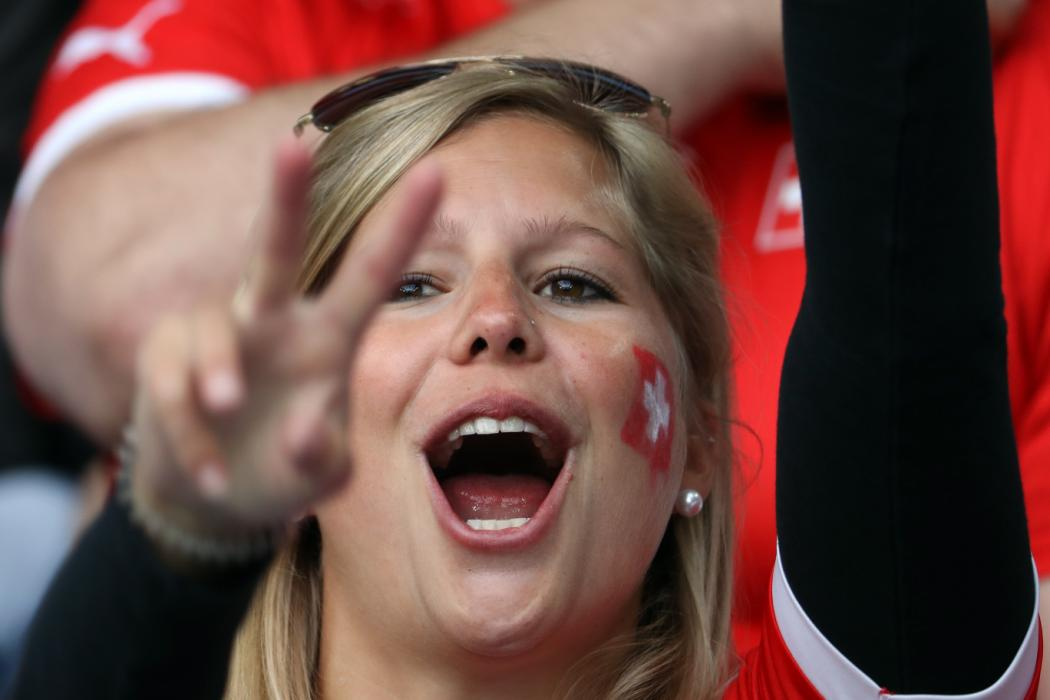 A Switzerland supporter poses prior to the Euro 2016 group A football match between Switzerland and France at the Pierre-Mauroy stadium in Lille on June 19, 2016. / AFP PHOTO / KENZO TRIBOUILLARD