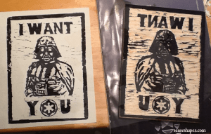A side by side comparison of my Darth Vader I Want You propaganda woodcut block and print.