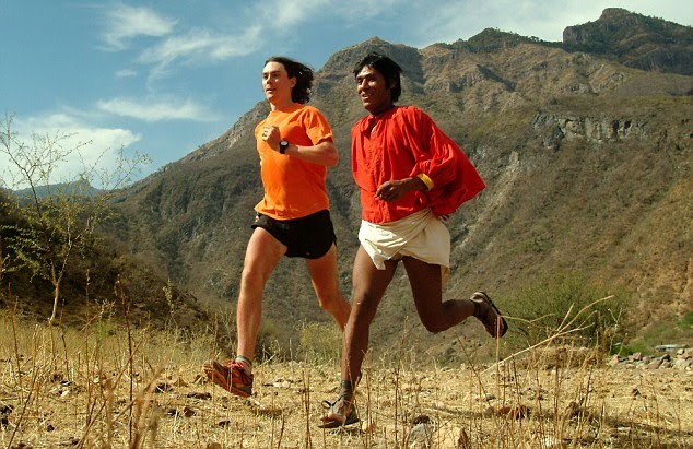 World class ultrarunner Scott Jurek running with Arnulfo a few years ago before the Copper Canyon Ultra. Source: barefootted.com
