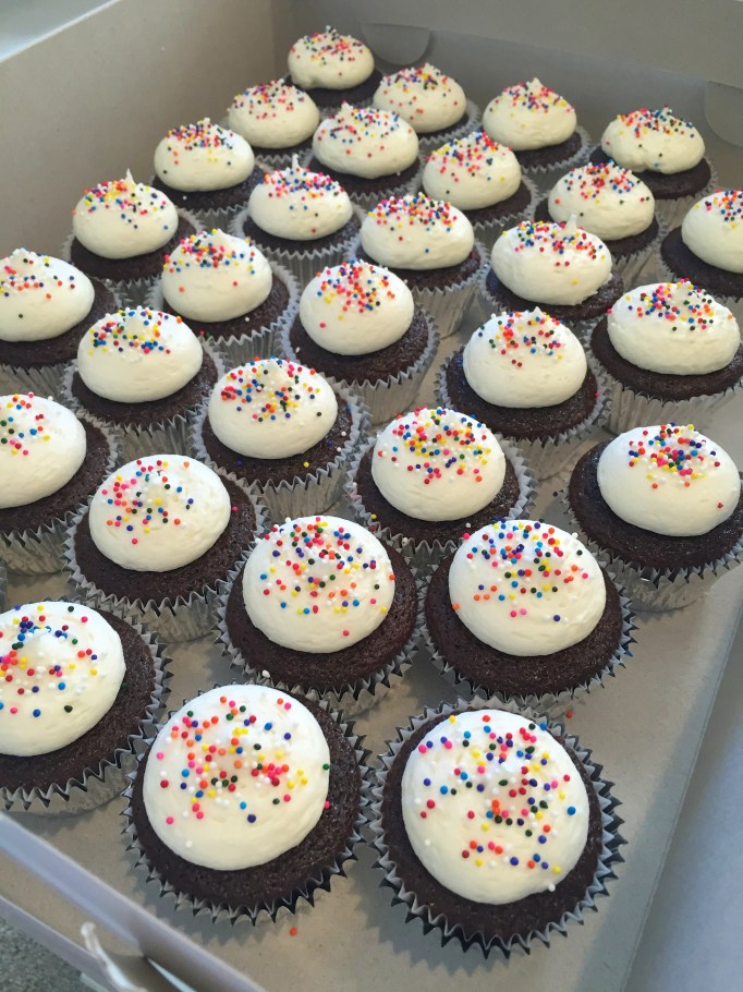 birthday cupcakes with sprinkles; chocolate cupcakes with vanilla cream cheese buttercream and sprinkles
