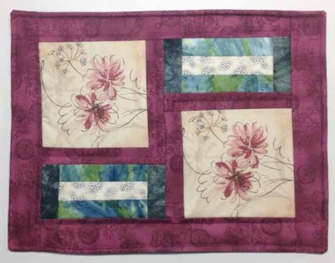 "by Louise Sundquist - ""I made four placemats using the challenge fabric and three other fabrics I purchased in Kirsten's shop."""