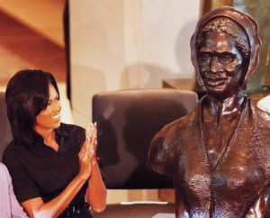 "Michelle Obama applauds during the unveiling April 28 of the bust of Sojourner Truth in Emancipation Hall of the U.S. Capitol in Washington. ""I hope that Sojourner Truth would be proud to see me, a descendant of slaves, serving as the first lady of the United States of America,"" Obama said. ""Now many young boys and girls, like my own daughters, will come to Emancipation Hall and see the face of a woman who looks like them."" - Photo: Manuel Balce Ceneta, AP"