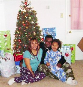 A week before BART Police Officer Johannes Mehserle stood over him and shot him in the back execution style, Oscar Grant celebrated Christmas with his loving family, Sophina Mesa and their daughter, Tatiana Grant. - Photo courtesy of Law Offices of John Burris