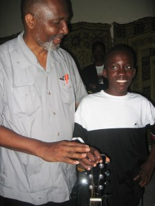 Father Gerry Jean-Juste, the father of Haiti, and Rosemond Jolissaint, Haiti's favorite son, met twice, becoming fast friends. Here they are together in Port au Prince. Rosemond, following musically in the footsteps of Father Gerry, decries injustice in his songs - calling, for example, for compassion, opportunity and dignity for street children - inspiring Haiti to fight on for true liberation. - Photo: Sasha Kramer