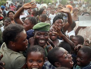 A Congolese government soldier is greeted as the army returns to Goma after M23 fighters withdrew. This crowd apparently shares a sense of national unity and pride said to be sweeping the Democratic Republic of Congo. – Photo: Goran Tomasevic, Reuters