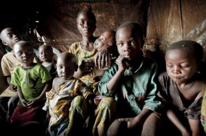 Mother, 7 children Mugunga III refugee camp outside Goma, Congo by Frederic Noy, UNHCR