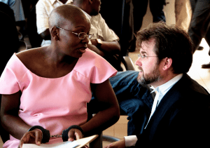 Victoire Ingabire, British atty Iain Edwards confer in court