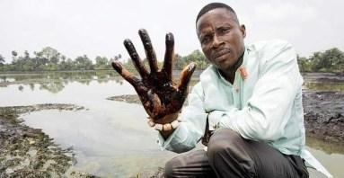 Niger Delta man oiled hand
