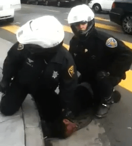 SFPD mashes Black youngsterGs face in sewer grate 012413 vid by Griz415