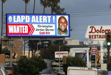 Christopher Dorner GwantedG poster digital billboard on Santa Monica Blvd by Reed Saxon, AP