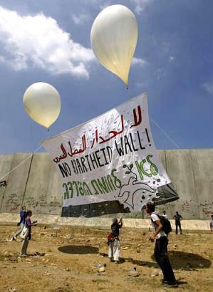 'No Apartheid Wall' banner raise Qalqilya, Palestine 073103