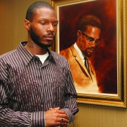 Malcolm Shabazz with Malcolm X portrait at LA Sentinel 0710 by LA Sentinel, web