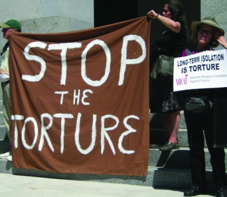Rally sign 'Stop the torture' for Ammiano SHU hearing 082311, cropped