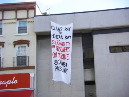 Solidarity banner from Collins Bay Fed Pen, Kingston, Ont., to Pelican Bay SP hunger strikers overlooks Kingston City Hall 070411