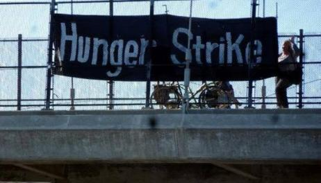 I-80 University Ave freeway pedestrian overpass 'Hunger Strike' banner 071013 by Mindy Stone