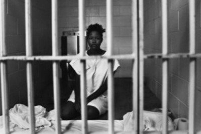 Black woman in solitary confinement