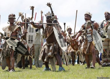 Zulu men perform traditional dance on hill overlooking Qunu during Mandela state funeral 121513 by Chip Somodevilla, AP