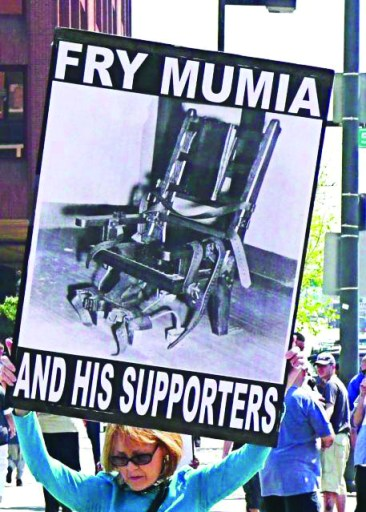 'Fry Mumia and his supporters' white woman