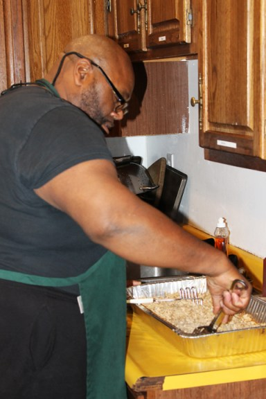 College Prep parent volunteer Ross Rose cooks dinner daily by Laura Savage