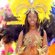 Intrepid traveler Harrison Chastang reveled with New Orleanians this month at the New Orleans Jazzfest. This is one of the Casa de Samba dancers. – Photo: Harrison Chastang