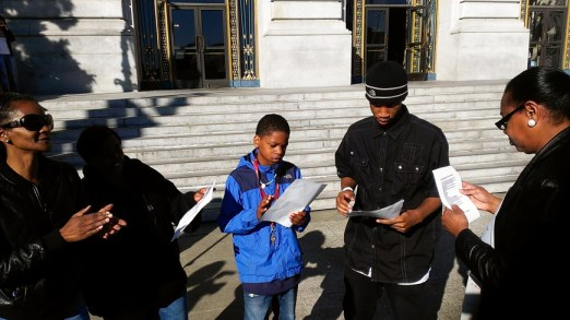 Sabrina Carter and sons sing spirit at City Hall 031114 by PNN