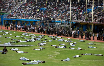 Performers portray the dead at a public ceremony to mark the 20th anniversary of the Rwandan genocide held in Amahoro Stadium in Kigali, Rwanda, April 7. – Photo: Ben Curtis, AP